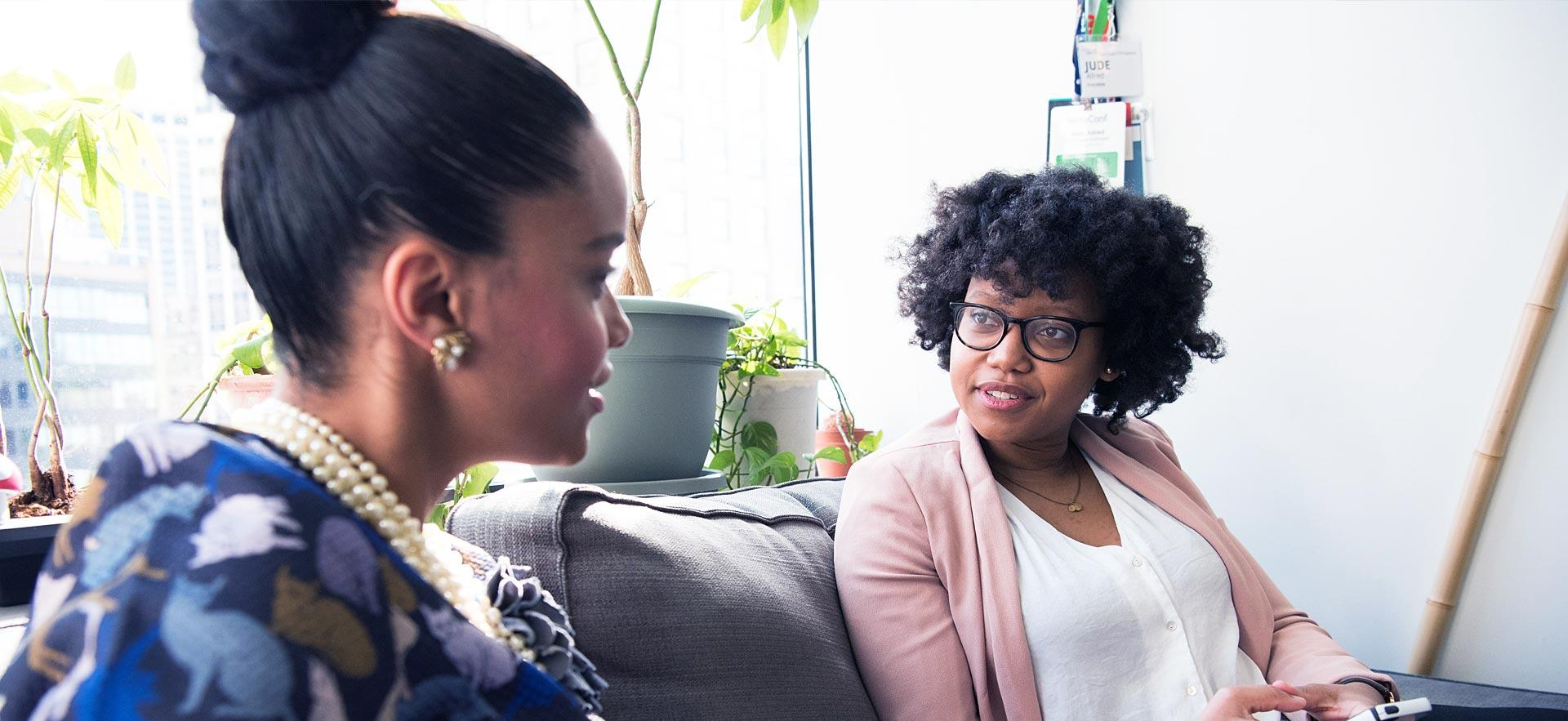 One female counsellor listens to a female client.