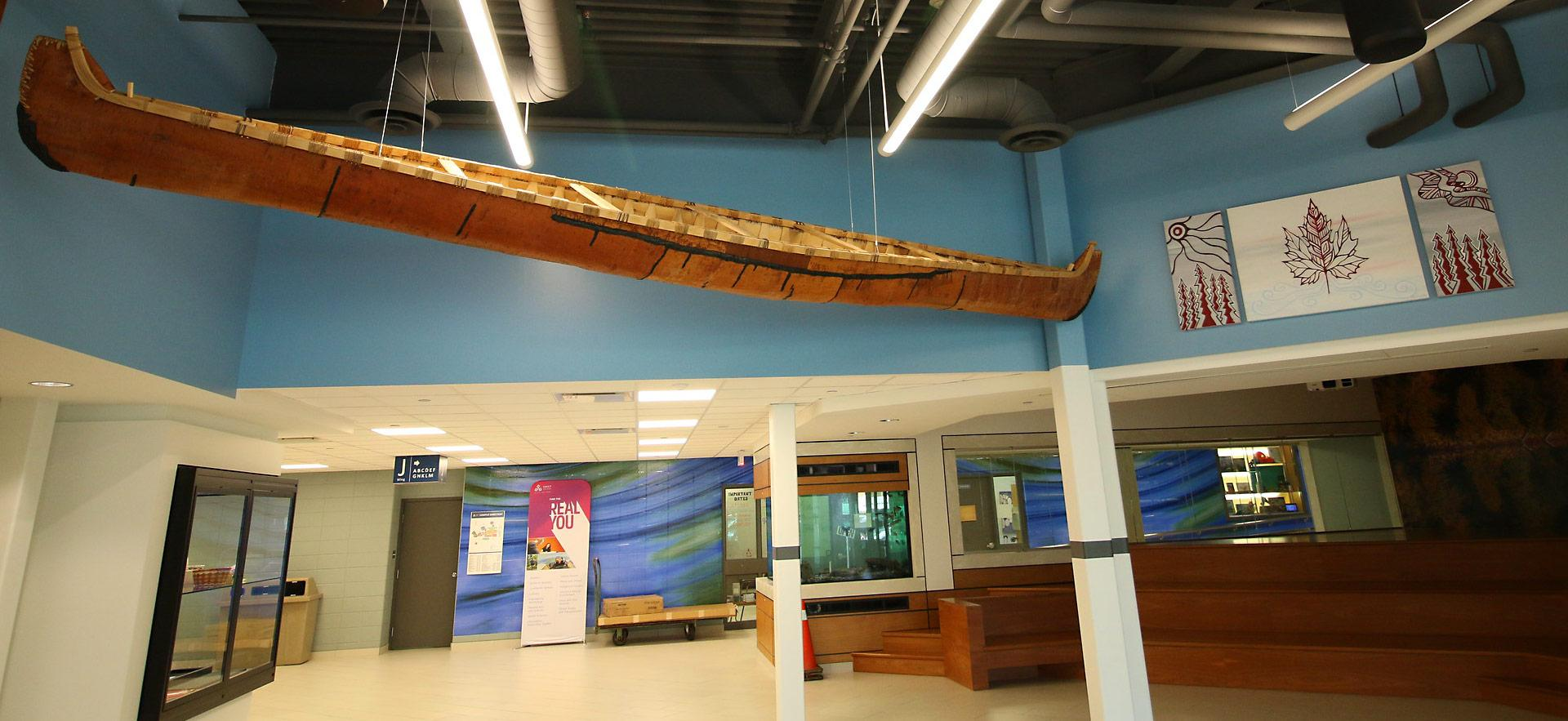 indigenous crafted canoe suspended in hall entry